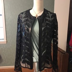 Jacket with leather on sheer fabric